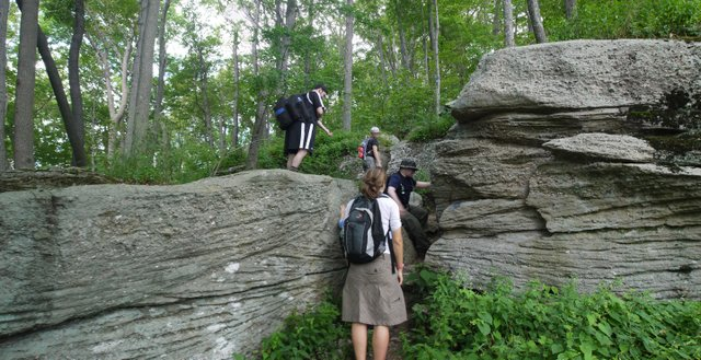 Hikers scramble up rocky ridges on Peekamoose Mountain