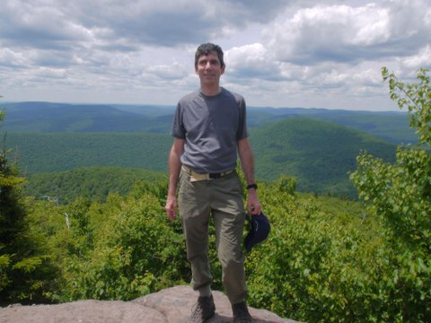 Charlie Stein poses at 3500' on Peekamoose Mountain